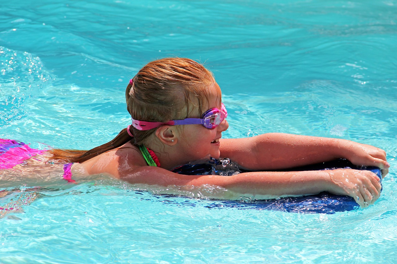girl swimming in a community pool