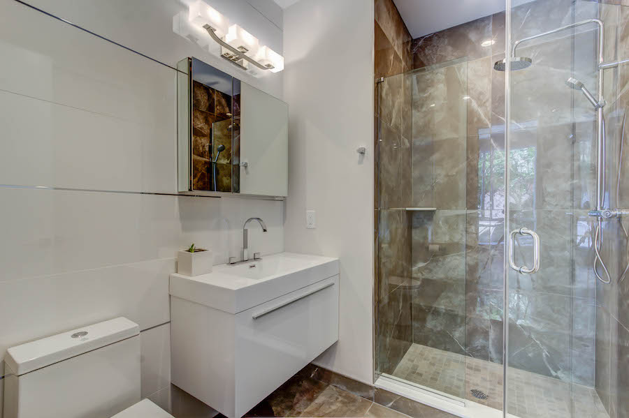 luxury white and wooden bathroom and shower